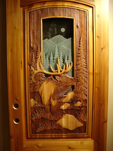 Carved elk door flickr photo sharing for Great home door designs