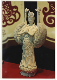 A thousanded armed Kuan Yin, store window, Hong Kong, 1990