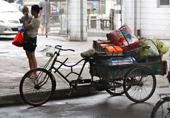 rickshaw(0.0), sports equipment(0.0), motorcycle(0.0), horse and buggy(0.0), carriage(0.0), bicycle(0.0), cart(0.0), bicycle trailer(1.0), vehicle(1.0), mode of transport(1.0), land vehicle(1.0), tricycle(1.0),