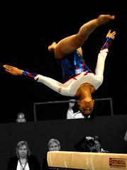 floor gymnastics(0.0), uneven bars(0.0), rings(0.0), balance beam(1.0), jumping(1.0), sports(1.0), gymnastics(1.0), gymnast(1.0), artistic gymnastics(1.0), performance(1.0), acrobatics(1.0),