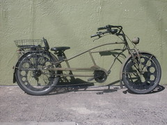 motorcycle(0.0), chopper(0.0), moped(1.0), wheel(1.0), vehicle(1.0), land vehicle(1.0), bicycle(1.0),