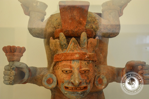 Finding Art and History in Cancun - Mayan Museum Desceding god