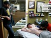 paco tattooing oni on scott's chest