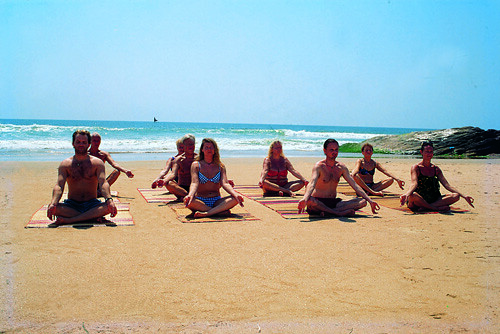 Yoga on the Beach by Kerala Tourism