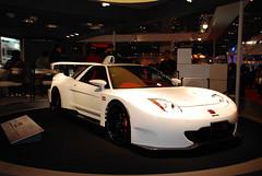 race car(1.0), automobile(1.0), automotive exterior(1.0), exhibition(1.0), vehicle(1.0), performance car(1.0), automotive design(1.0), auto show(1.0), honda(1.0), honda nsx(1.0), land vehicle(1.0), supercar(1.0), sports car(1.0),