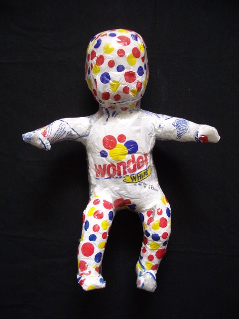 """Lil' Wonder"" recycled plastic bag art doll sculpture"