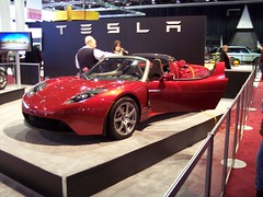 race car(1.0), automobile(1.0), tesla(1.0), tesla roadster(1.0), vehicle(1.0), automotive design(1.0), auto show(1.0), land vehicle(1.0), luxury vehicle(1.0), supercar(1.0), sports car(1.0),