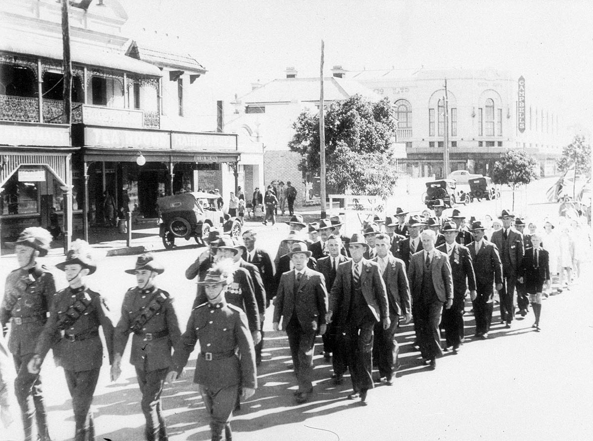 Light Horse lead the Anzac Day March, Kelly Street, Scone, ca. 1935 / photographed by J.A. Smith