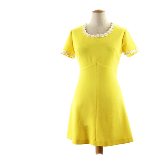 Vintage bright yellow mini dress with white daisy trim.