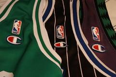 ball(0.0), sleeve(0.0), outerwear(0.0), t-shirt(0.0), sports uniform(1.0), clothing(1.0), green(1.0), jersey(1.0), sportswear(1.0),
