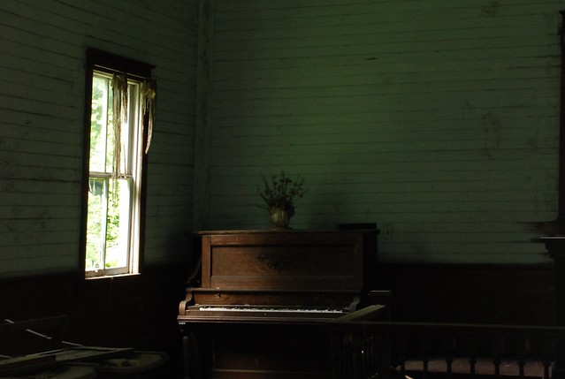 Old piano in abandoned church
