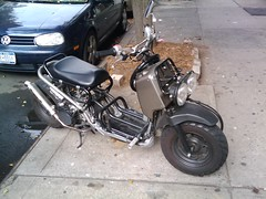 automotive exterior, moped, wheel, vehicle, motorcycle, bumper,