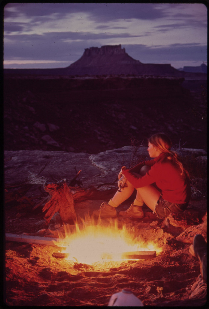 Camping in the Maze, a Remote and Rugged Region in the Heart of the Canyonlands. Because It Seldom Rains, Tents Are Not Necessary. Firewood Is Dry and Plentiful. Ekker Butte Rises in the Background, 05/1972