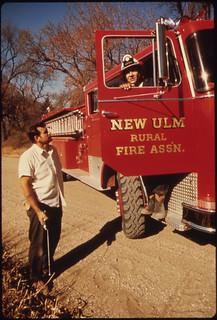 """Wallace """"Whitey"""" Wolf (In Truck) Is a Lieutenant in the Volunteer Fire Department ..., 10/1974"""