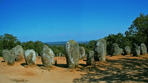old blue trees light shadow orange hot green history portugal archaeology megalithic standing circle site ancient standingstones scenery europe view stones group drawings sombra location structure boulders solstice enjoy neo guadalupe oaks 169 alentejo archeology complex neolithic enclosure alignment align évora cromlech menhir almendres carveddrawings
