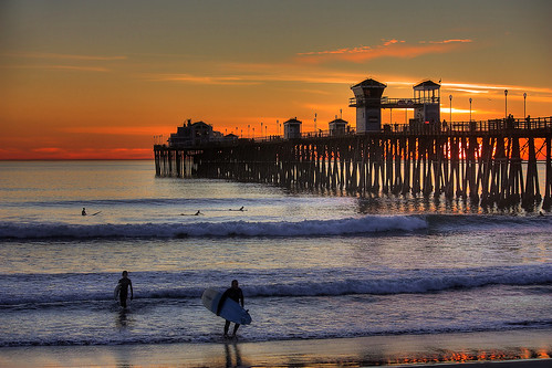 ocean california sunset beach pier twilight surf waves dusk sandy father son surfing oceanside surfers breathtaking breathtakinggoldaward breathtakinghalloffame mygearandme mygearandmepremium mygearandmebronze mygearandmesilver