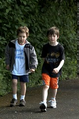 nick walking with a friend in the jog a thon