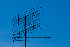 outdoor structure(0.0), electrical supply(0.0), overhead power line(0.0), mast(0.0), wind(0.0), transmission tower(0.0), electricity(0.0), tower(0.0), television antenna(1.0), line(1.0), sky(1.0), antenna(1.0),