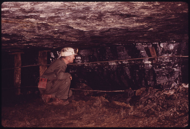 DOCUMERICA: George Wilson in His Drift Mine (One That Is Cut Straight Into a Hill) near Wilder and Cookeville, Tennessee. It Was Closed Down by Federal Mine Inspectors Because He Lacked a Non-Arcing Drill Wilson Said Such a Drill and Allied Equipment Would Cost Him $100,000 to Reopen the Mine. Note the Height of the Shaft. The Lines on the Side Are Called Escape Wires Which a Miner Could Use to Find His Way to Safety in the Event of a Mine Disaster. April, 1974 by Jack Corn.