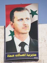 A Syrian government propaganda poster portraying Bashar al-Assad.  Image from copepodo's photostream