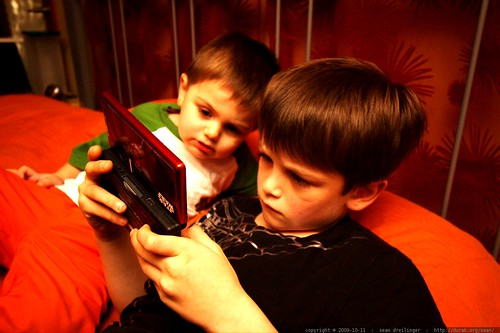 brothers bonding over a nintendo ds gaming session    MG 6070