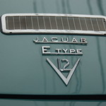 Old Jaguar E-type sports car: logo & vent on trunk lid