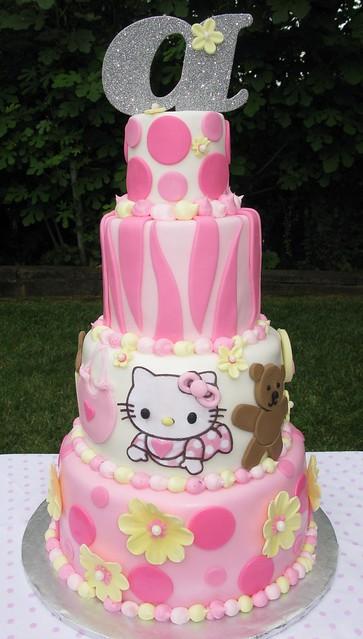 hello kitty baby shower cake with pink zebra print