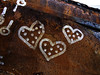 Silver hearts on rust