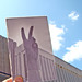 Peace sign + UWGB Environmental Sciences Building now/then