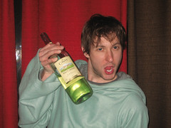 Man holding bottle of wine with snuggie