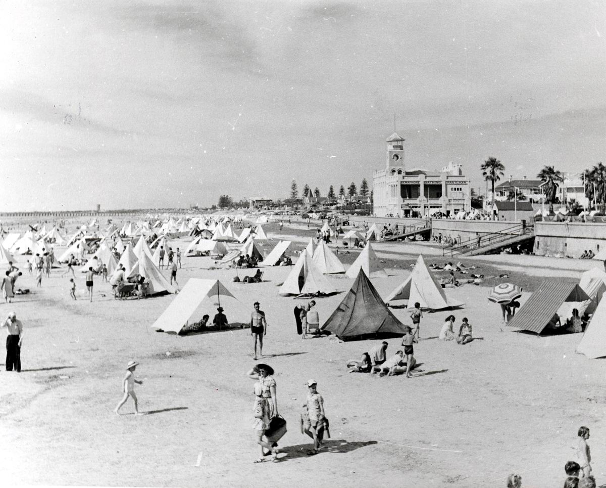Photo of vacationers on Semaphore Beach, South Australia circa 1950