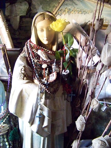 Rosaries, flowers and statue at St. Bridget's Well