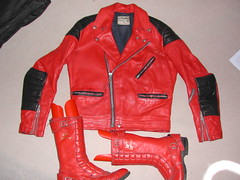 textile(1.0), leather jacket(1.0), clothing(1.0), red(1.0), sleeve(1.0), leather(1.0), outerwear(1.0), jacket(1.0),