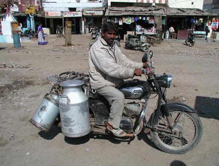 India: Transporting fresh milk by motorbike