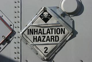 Breathe and die. HAZMAT 2-3. Poison gas placard.
