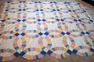 I love it when the intersection points have bold colors.  This quilt top has a delightful history. Details about the (probable) maker, and this quilt top's future, are at domesticat.net/quilts/bessie-jane