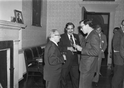 Photograph of Milton Gustafson Enjoying the Conversation at the Reception in Room 105 for the Conference on Research and Historical Geography, 1971