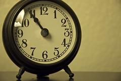 hand(0.0), furniture(0.0), gauge(0.0), decor(1.0), alarm clock(1.0), close-up(1.0), clock(1.0),