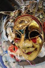 festival(0.0), clothing(0.0), goaltender mask(0.0), costume(0.0), headgear(0.0), masque(1.0), head(1.0), mask(1.0),
