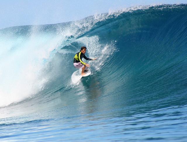 Smooth wave riding at Teahupoo, Tahiti.