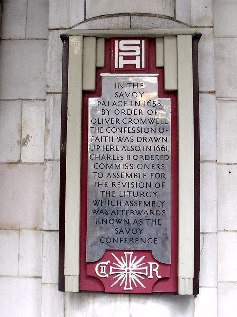 Charles II and Oliver Cromwell grey plaque - In the Savoy Palace, in 1658 by order of Oliver Cromwell, the Confession of Faith was drawn up. Here also, in 1661, Charles II ordered commissioners to assemble for the revision of the liturgy, which assembly was afterwards known as the Savoy Conference