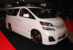 compact car(0.0), automobile(1.0), automotive exterior(1.0), vehicle(1.0), toyota alphard(1.0), minivan(1.0), compact sport utility vehicle(1.0), auto show(1.0), bumper(1.0), land vehicle(1.0), luxury vehicle(1.0),