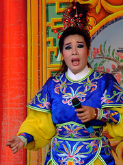 child(0.0), tradition(1.0), peking opera(1.0), costume(1.0), person(1.0),