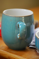 art(0.0), bowl(0.0), saucer(0.0), green(0.0), cup(1.0), cup(1.0), pottery(1.0), drinkware(1.0), turquoise(1.0), tableware(1.0), coffee cup(1.0), mug(1.0), ceramic(1.0), blue(1.0), porcelain(1.0),