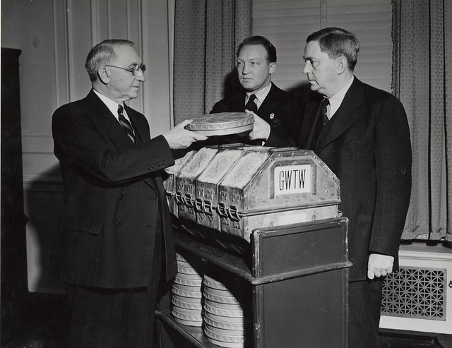 "Photograph of First Archivist of the United States R. D. W. Connor Receiving Film ""Gone With The Wind"" from Senator George of Georgia and Loew's Eastern Division Manager Carter Barron, 1941"