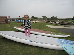 Bella Porter learning how to surf in Cape Hatteras NC