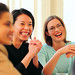 Businesswomen laughing in meeting by hermannyin