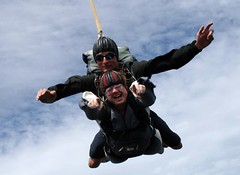 parachute(0.0), tandem skydiving(1.0), air sports(1.0), sports(1.0), parachuting(1.0), windsports(1.0), extreme sport(1.0), stunt performer(1.0),