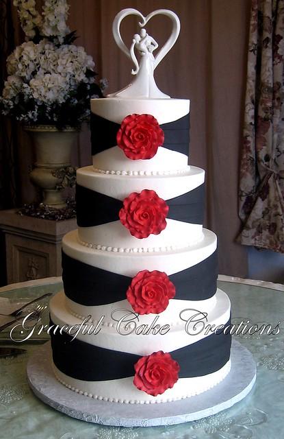 Elegant White and Black Wedding Cake with Red Roses ...