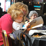 Getting to grips with the brochure | Mum and toddler browsing the programme